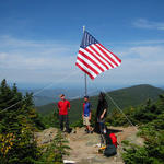 Old Glory atop Carter Dome - with the crew: Rob, Jeff, and Jon