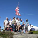 U.S. flag flying atop Mt. Isolation with sponsoring group and new friends after our moment of silence